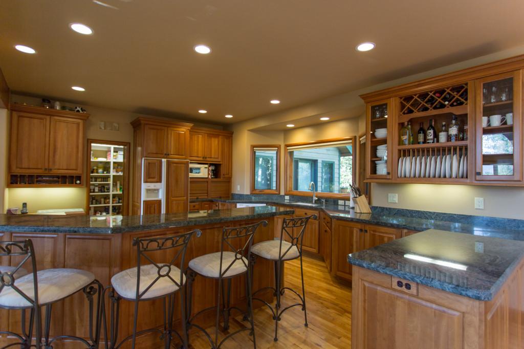 Granite countertops, island seating and walk-in pantry.