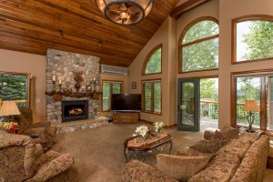 River rock fireplace, tongue and groove ceiling and decks all around.