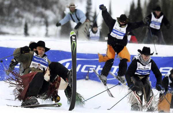 Cowboys skiing to the finish line during Steamboat's Cowboy Downhill.
